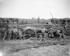 troops-of-the-royal-field-artillery-swinging-a-60-pounder-gun-to-haul-up-into-position-bazentin-le-petit-october-1916